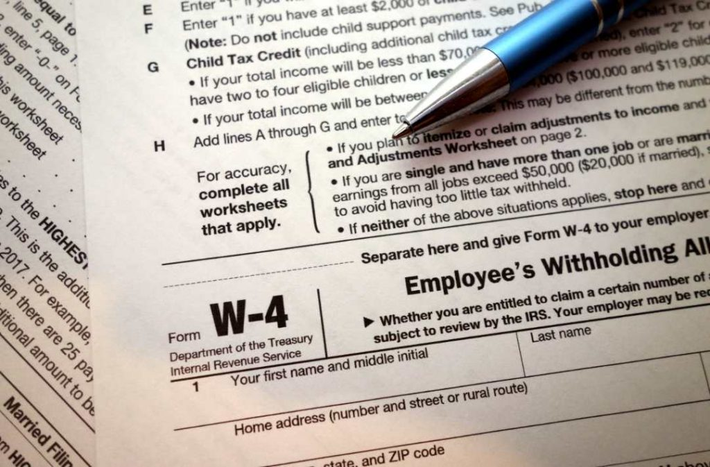 A W-4 form is viewed in New York. As the covid19 pandemic took hold this spring, the federal government postponed the traditional April 15 filing deadline until July 15.