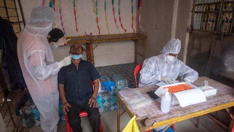 Health care workers during Covid-19 swab testing campaign inside a residential complex at Chembur in Mumbai on Monday.